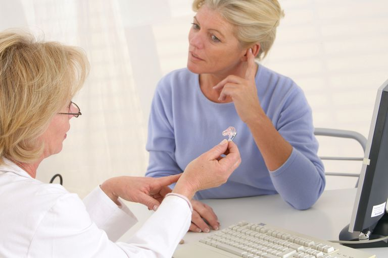 woman-talking-to-doctor-about-hearing-aids-149320486-58b5e8cb3df78cdcd8fcbbe8